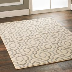 Arabesque Diamonds Area Rug Graceful arabesque diamonds flow over the surface of this plush carpet for distinctively luxurious style in your bedroom, living or dining room. Available in large room size rugs or runners in 3 color combinations; Beige with silver gray and stone, steel Gray with putty, and pastel Green and blue over cream. 70% wool - 30%PET polyester blend for added softness and durability. Imported