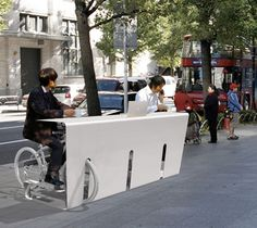 cool street desk, wonder if you can pedal to create juice to run your laptop or charge your phone?