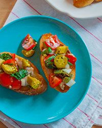Pickled okra is a salty surprise in this traditional Italian appetizer, served on an oven-toasted crostini.