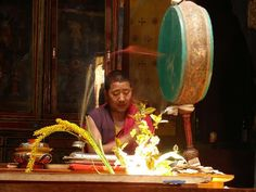 A buddhist monk offering prayers at the Thiksey Monastery, Ladakh