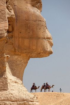 The Sphinx,Giza,Egypt~The Great Sphinx of Giza commonly referred to as the Sphinx, is a limestone statue of a reclining or couchant sphinx (a mythical creature with a lion's body and a human head) that stands on the Giza Plateau on the west bank of the Nile in Giza,Egypt.It is the largest monolith statue in the world,standing 73.5 metres(241 ft)long,19.3 metres (63 ft)wide,and 20.22 m(66.34 ft) high.