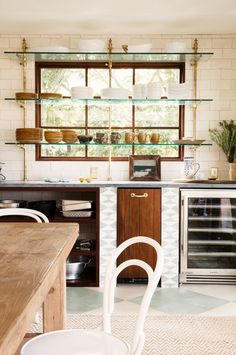 Open Shelving in Front of a Kitchen Window - Glass shelves great not so much the gold brackets Kitchen Ikea, Big Kitchen, Kitchen Shelves, Brass Kitchen, Kitchen Storage, Pantry Storage, Storage Area, Kitchen Window Shelves, Kitchen Island