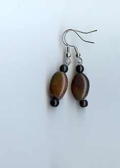 Cocoa Beans Beaded Earrings in Chocolate Brown and Black. $10.00, via Etsy.