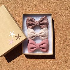 Textured mauve, winter white, and mauve hair bows from seaside sparrow. on Etsy, $11.00