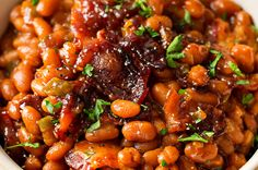 These Brown Sugar and Bacon Baked Beans are the perfect blend of sweet, savory and smoky! Topped with delicious bacon, they're always a hit, and are SO easy to make! Easy Baked Beans, Baked Beans With Bacon, Pork N Beans, Baked Bean Recipes, Vegetable Side Dishes, Vegetable Recipes, Cooking Recipes, Healthy Recipes, Crockpot Recipes