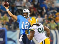 Tennessee Titans quarterback Charlie Whitehurst (12) passes against Green Bay Packers defensive end Khyri Thornton (94) during the first half at LP Field. Mandatory Credit: Don McPeak-USA TODAY Sports