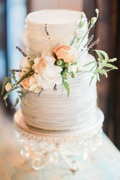 Rustic wedding cake idea - two-tier, buttercream-frosted wedding cake with fresh flowers {CiBi Events}
