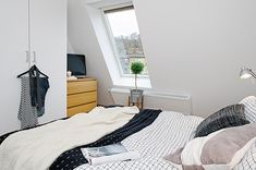 Compact Attic Apartment With a Gorgeous Simple Design in Sweden - http://freshome.com/2012/12/04/compact-attic-apartment-with-a-gorgeous-simple-design-in-sweden/