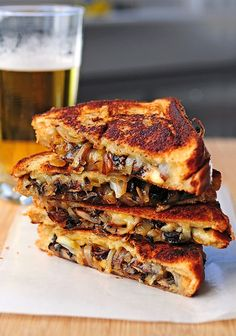 GRILLED CHEESE WІТН GOUDA, ROASTED MUSHROOMS АΝD ONIONS -------------------------------------------------------------Ingredients and Recipe--------   -------  8 ounces mushrooms, sliced     1 medium onion, sliced     2 tablespoons olive oil     salt аnd pepper     4 tablespoons butter     4 slices bread оf choice     1 cup gouda, shredded