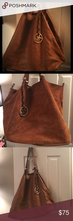 Michael Kors Reversible Suede and Leather Tote Very Good Used Condition - super versatile as this bag is reversible. Can wear it all leather or all Suede. Large tote Michael Kors Bags Shoulder Bags