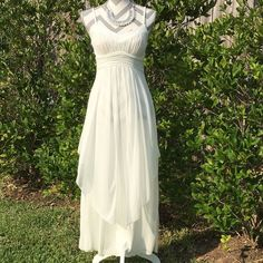 💄HP💄Ivory Chiffon Wrapped Dress Top of dress is fully lined with cups. Chiffon pleated bust & waistband. Regular Long dress top with a chiffon skirt on top with another shorter layer of chiffon on top in front that's shorter & split down the middle.100%polyester, hand wash. NWOT Size 4, fits like a 2! HP Chosen by Jennifer😘@jennfin 6/18/16 Check our Jennifer's Beautiful closet!😘💕💕💕 Dresses