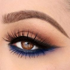 "I love this modern twist on a smokey eye. Keep the upper lid toned down with medium brown shades and a feline flick to create that sexy cat eye. Then add a ""pop"" of colour to the lower lash line using a crayon eyeliner smudged out with shadow to really intensify your chosen shade. Great colour choices are rich tones of blue, purple and green."
