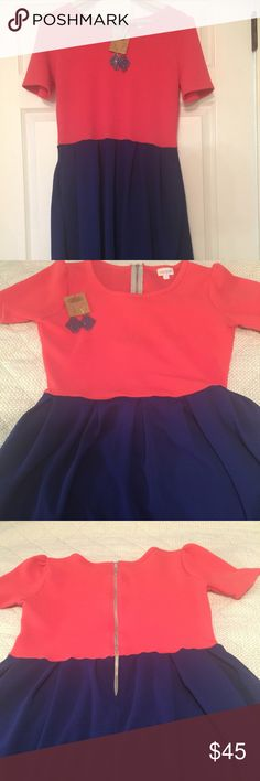 Adorable LulaRoe Amelia NWOT and Plunder Earrings LulaRoe Coral and Navy Blue Amelia Dress and Plunder NWT Navy Filigree Earrings Retail is $65 for Dress Comes with earrings but not pearls! LuLaRoe Dresses