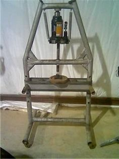 Press by sneakysnake -- Homemade press constructed from pipe, channel, springs, and a bottle jack. http://www.homemadetools.net/homemade-press-6