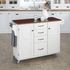 This attractive cart from Home Styles features a white finish with a three quarter inch cherry finished wood top. In addition, this piece features a durable, solid wood construction and wheels for mobility.