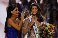 Miss France Iris Mittenaere waves after being declared winner in the Miss Universe beauty pageant at the Mall of Asia Arena, in Pasay, Metro Manila, Philippines. - AFP.