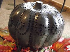 Dollar Tree pumpkins-painted with spray paint and acrylic detail