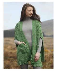 100% finest Merino Wool. Pocket Shawl / Wrap displaying Irish knitting patterns and stitches from the fisherman culture of the Aran Islands.Great gift - one size fits all.
