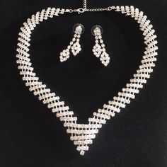 """✨Beautiful Rhinestone Necklace and Earrings✨ V-shaped rhinestone necklace with complimentary earrings. All stones present and color clear. Chain extends 4"""". Jewelry Necklaces"""