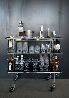 A Home Bar is an essential element to your game room, man cave, or wherever you want to entertain in your home. We offer plenty of classy and fun bar furniture ideas for the home, including all the accessories you'll need like bar stools and wine racks. Mini Bars, Bar Cart Styling, Bar Cart Decor, Silver Bar Cart, Black Bar Cart, Bar Trolley, Drinks Trolley, Bar Design, Interior Decorating