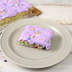 Whip up some colorful magic with these delightful Unicorn Bars! They're topped with a pillow-y purple frosting and rainbow sprinkles for good vibes!