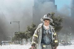 "An unidentified New York City fireman walks away from Ground Zero after the collapse of the towers. Photographer Anthony Correia told LIFE.com of this picture: ""He just looked so exhausted, so beat up."" Correia knelt down and took his shot as the man walked by. ""I acknowledged him, and he acknowledged me. But he never stopped."" The steady gaze, meanwhile, of this lone firefighter allows us a window into the experience of literally thousands of rescue workers and first responders. I was in…"