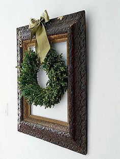 Framed Wreath                  For a fresh take on displaying your holiday wreath this season, highlight it in an empty vintage or new picture frame. Fasten with a gold bow.