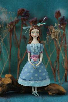 """""""Girl in a blue dress. Hanging sculpture  by Elya Yalonetski"""" by Elya Yalonetski. Sculpture, Subject: People and portraits, Naive style, One of a kind artwork, Signed on the back, Size: 12.5 x 28 x 8.5 cm (unframed), 4.92 x 11.02 x 3.35 in (unframed), Materials: clay, engobe, glaze"""