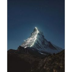 Instagram photo by colbyshootspeople - The Matterhorn under the stars. This year is the 150th anniversary of the first ascent, so at night they light up the route the climbers used. Switzerland is the dang coolest!