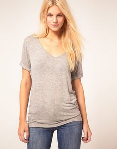 ASOS New Forever T-Shirt Jersey t-shirt by ASOS Collection. Crafted in a lightweight stretch jersey fabric. Featuring a wide v-neckline with a narrow ribbed trim, a relaxed fit through the body, and short sleeves with stitched turn up cuffs.