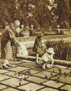 http://www.bkgstory.com Vintage Photograph   Feeding the birds, Hyde Park, London, 1920's