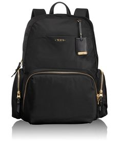 """Calais Backpack – This backpack is ideal for business, travel and everyday outings. It has a laptop (15"""") pocket and other interior organizer pockets for electronics and personal accessories. Several exterior pockets for fast-access items. Made from lightweight nylon with leather trim, it has a leather carry handle and padded shoulder straps. #TUMI"""
