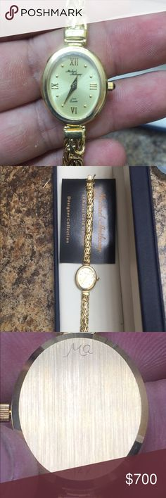 """Ladies 14K Yellow Gold Michael Anthony Watch Ladies 14K Yellow Gold Michael Anthony Watch   This Beautiful Michael Anthony Swiss Quartz 14K Yellow Gold Ladies Watch has exquisite gold workmanship.    The box clasp includes a safety lock on the side.   In great working condition  New battery installed prior to listing  19 grams approx total weight with movement  Aprox 7"""" in length  Comes packaged in original box.   Brand new no scuffs   We do have layaway, great Christmas present  This is not…"""