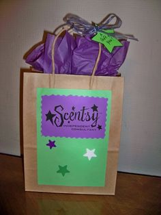 gift bag, would be cute gift bag and if a customer is at and event will promote by walking around with it.