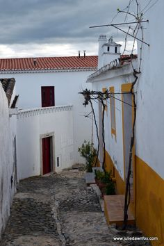 Medieval Mértola: an Unspoilt Gem Awaits in the Alentejo - via Julie Dawn Fox 14.05.2015 | One of Mértola's merits is its location. Ensconced within the Guadiana Valley Natural Park, the alluring medieval village is also a convenient base for nature lovers wanting to go on walks or adventures in the countryside. The historical centre of Mértola is built on a hill where the Ribeira de Oeiras joins the larger Guadiana River. If you climb to the top of the castle tower, you'll see what I mean…