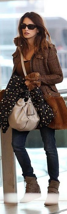 Who made Penelope Cruz's studded sneakers and tan coat? Purse – Loewe  Coat – Chanel