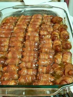 ANother BIG hit!!!! Super easy. MAke sure to use a large enough dish that you can roll the weenies to get bacon fully cooked. Wrap weenie in 1/3 strip bacon. Melt 1 stick butter and mix with 1 cup brown sugar. Pour over weenies. sprinkle another 1 cup brown sugar over weenies. Cook @ 400 for 15-20 min. Turn and cook for 5 more min till crisp: