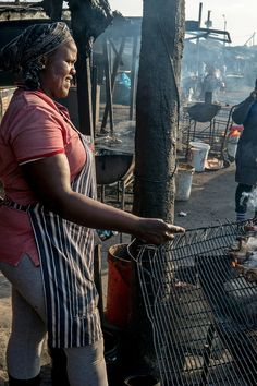 "In Zulu, the term for braai is shisa nyama, which roughly translates to ""burn meat."" The term has been adopted by speakers of other African languages here. (Photo: Joao Silva/The New York Times)"