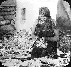 Hopi woman weaving a basket.  Photographed by Henry Peabody, ca. 1900.