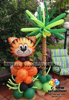 Jungle Theme Party Decorations – Balloon sculpture Tiger with balloon palm tree – Extreme Decorations Miami, FL extremedecoration - - Party Animals, Animal Party, Jungle Theme Birthday, Jungle Theme Parties, Safari Party Decorations, Party Themes, Balloon Palm Tree, Ballon Arrangement, Baby Shower