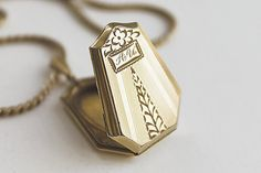 The geometric details on this Art Deco locket. | 14 Vintage Locket Details That Are Utterly Delightful