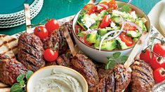 Spiced Beef Kabobs with Herbed Cucumber and Tomato Salad Recipe - Southern Living