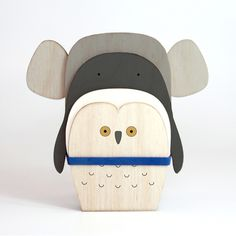 Slices of wood are layered in different combinations to make each animal in this toy menagerie.