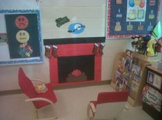 Reading by the fire in the library during our winter theme. We created a fireplace using bulletin board paper.