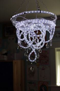 "3 easy DIY home lighting projects. A fun and cheap way to ""remodel"" your home on a budget. Rope light chandelier, DIY canvas light, and a LED strip light floating mirror!"