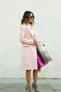 Total street style crush on Lace and Locks in our long blush pink double-breasted coat. She styles it over a cream dress and accessorizes with a plaid scarf and bright pink bag | Banana Republic