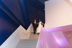 Couple Walking Down Stairs of Venue