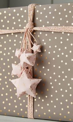 Star bright! From the subtle beauty of the wrapping paper to the burst of stars instead of a bow, make your gifts shine.