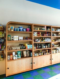 The shelving and fixtures were designed by Goodrich and custom-built by Dusk Studio, and have an oil finish to let the wood breathe. Custom Made Furniture, Furniture Making, Tobacco Shop, Atwater Village, Parisian Cafe, Retail Interior, Retail Space, Store Fronts, Vinyl Flooring