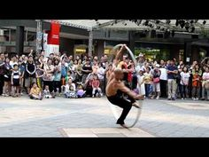 Street Performer Flows With Giant Wheel!